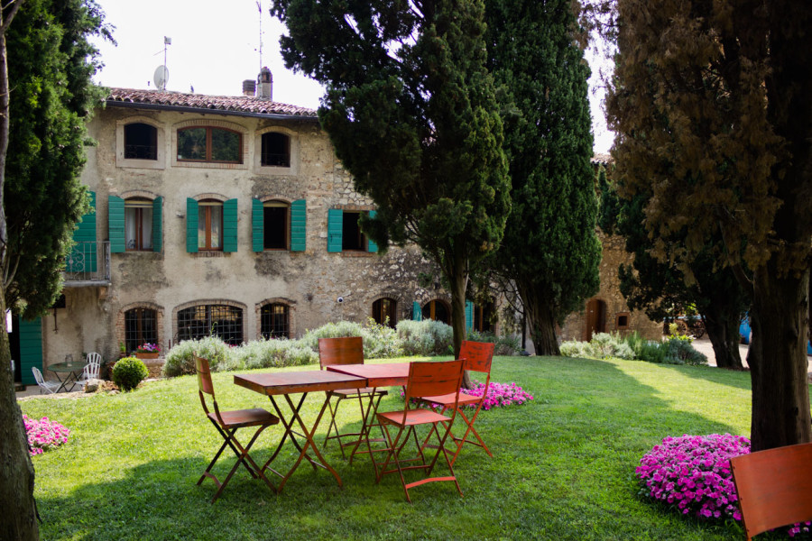 table with chair outside massimago wine relais