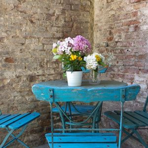 light blue table with flowers in massimago wine tower