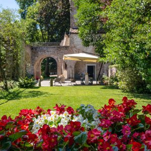 garden with flowers in massimago wine tower